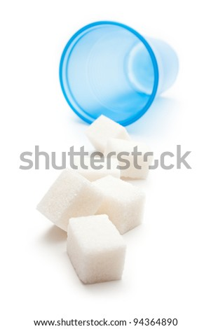 Cubes of sugar with plastic cup