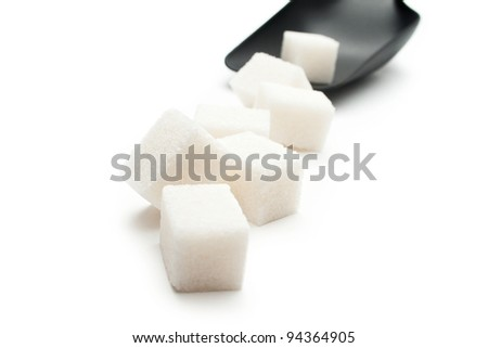 Cubes of sugar with plastic spoon