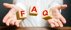 Cubes thrown by a man make word abbreviation acronym FAQ (frequently asked questions). Instructions and rules. Avoid frequent errors. Convenient form of answers explanations for users and customers.