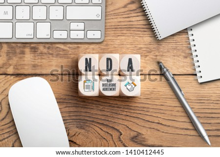 """Cubes with acronym NDA for """"non disclosure agreement"""" on wooden background #1410412445"""