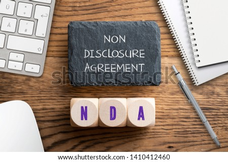 """Cubes with acronym NDA for """"non disclosure agreement"""" on wooden background #1410412460"""