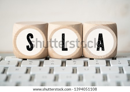 """cubes with acronym SLA for """"service level agreement"""" on a keyboard #1394051108"""