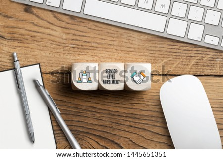 """cubes with acronym SLA for """"service level agreement"""" on wooden background #1445651351"""