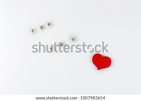 cubes with letters and wooden red heart on a white background #1007983654