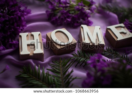 Cubes. Wooden cubes, Cubes with letterins. Cubes with letterins Home. Orchid and spa stones on a stone background. Spa and wellnes scene. Pink flowering tulips on a tulip field in spring.  #1068663956