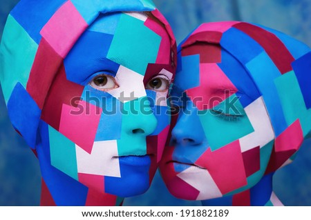 cubism styled ladies wiyh angular face-art isolated on blue background