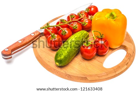 cucumber pepper and tomatoes on a cutting board