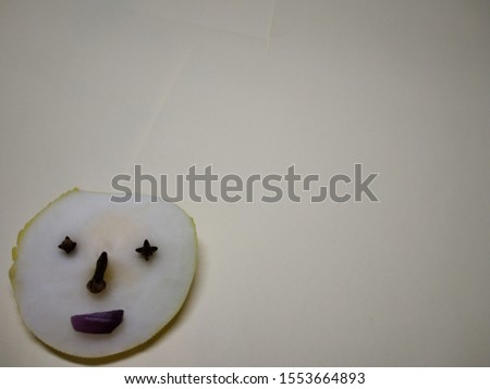 cucumber piece with onion piece and cloves on papers