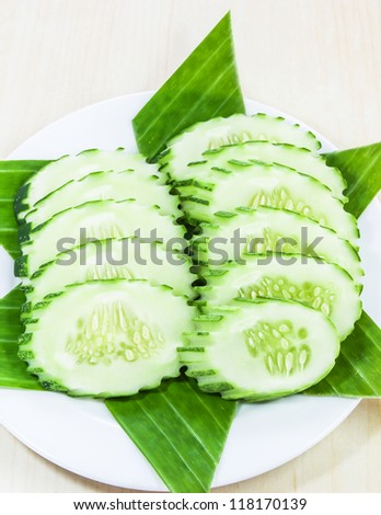Cucumber sliced on white plate