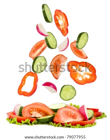 cucumber, tomato, pepper, garden radish of  fall on vegetables lying a heap on a white background