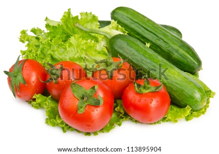 Cucumbers and tomatoes ready for salad - stock photo
