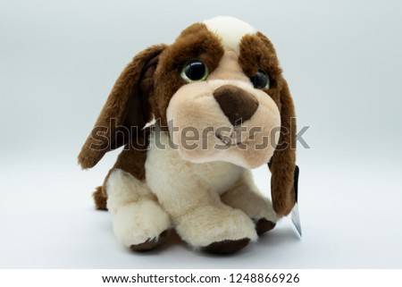 Cuddly Brown and white cuddly dog toy designed from a spaniel type dog.
