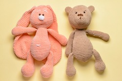 Cuddly toys on color background