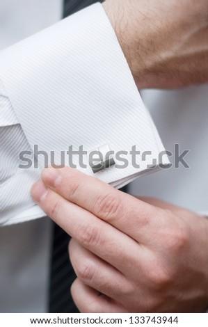 Cuff link, man is getting dressed