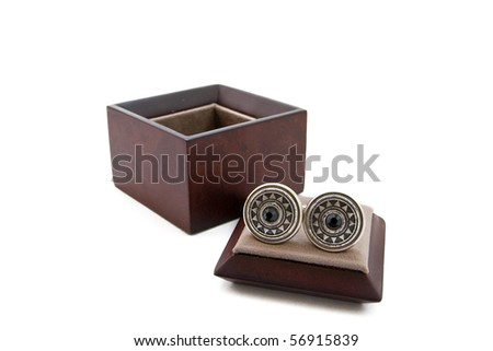 Cuff links in a box on white background - stock photo