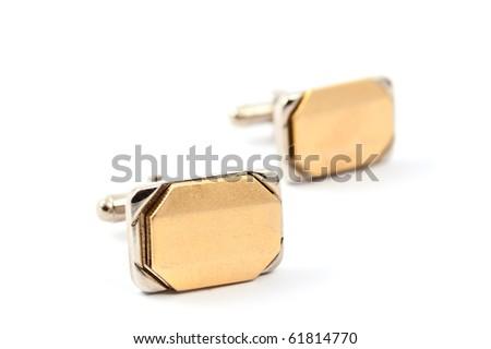 cufflinks on a white background