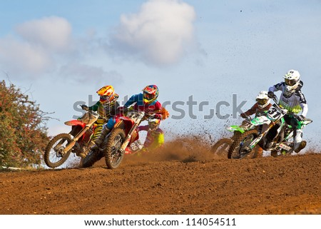 CULHAM, UK - SEPTEMBER 22: Jason Dougan, number17,  leads Alex Snow and Gert Krestinov into turn one at Culham Park during the UK Red Bull Pro Nationals MX1 class moto2 on September 22, 2012 in Culham