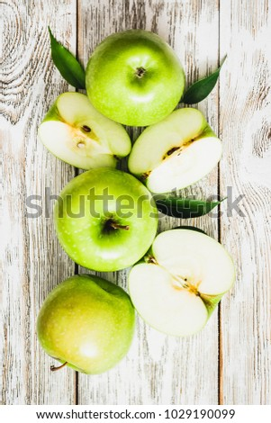 Culinary background, green apples on shabby white wooden background. Top view, copy space. stock photo