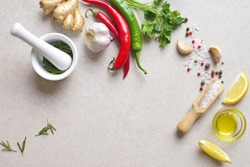 Culinary background, view from above on culinary ingredients laying down on stone kitchen table surface, blank space for a text