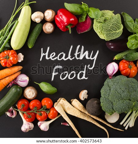 culinary background with fresh farm vegetables #402573643