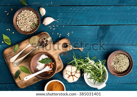 Shutterstock culinary background with spices on wooden table