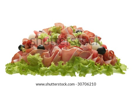 Culinary bouquet made of sausage, ham, fruit, greens and olives