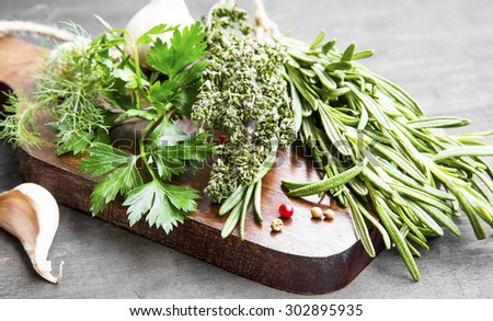 Culinary Herbs with Parsley,Dill,Rosemary and Thyme on Wooden Board