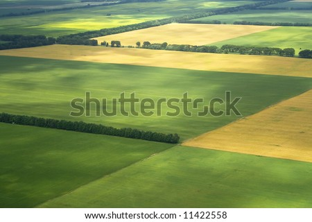 cultivation farm agriculture fields landscape with green blocks as zoning land - stock photo