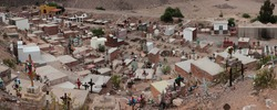 Culture and religion. Panorama view of an aboriginal cemetery high in the mountains. The grave and tombstone pattern along the hill.