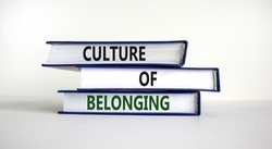 Culture of belonging symbol. Books with words 'culture of belonging' on beautiful white background. Business, culture of belonging concept. Copy space.