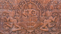 culture stone carving on wall.