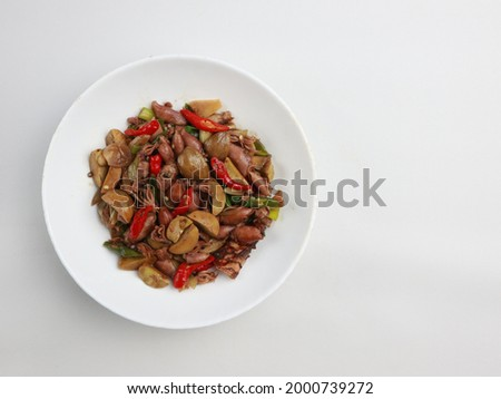 Cumi asin jengkol asam manis or stir fried of salted squid with jengkol or dogfruit. Indonesian traditional food, especially in javanese. Selective focus.  Stock fotó ©