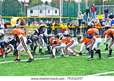 CUMMING, GA - OCT 17: Scrimmage line of a football game. A team of 7-9 year old boys October 17, 2009 in Cumming GA.  The Broncos vs The Eagles.