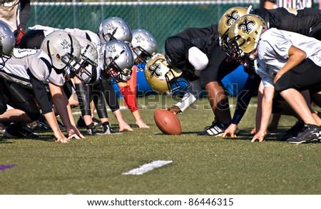 CUMMING, GA - OCTOBER 8: Several unidentified age 11 to 13-year-old  boys at the line of scrimmage, the Raiders vs the Saints, on October 8, 2011 in Cumming, GA.