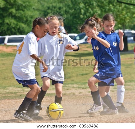 CUMMING, GA/USA - MAY 8: Unidentified young girls during a soccer game May 8, 2010 in Forsyth, County, Cumming, GA.  A regular season game of girl's 8 and under. The Fusion Fury vs the Cheetahs.