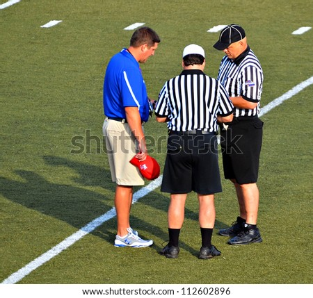 CUMMING, GA/USA - SEPTEMBER 8: Unidentified coach and officials before a football game of 7th grade boys September 8, 2012 in Cumming GA. The Wildcats  vs The Mustangs.
