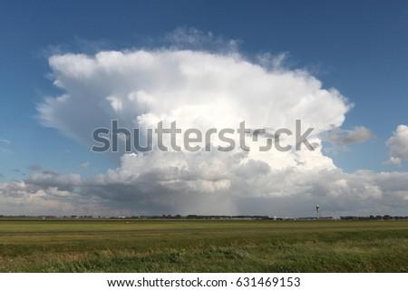 Cumulonimbus capillatus above airport