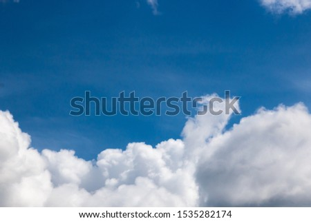 cumulus and high-cumulus clouds of an average tier on blue heavenly space #1535282174