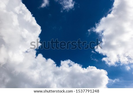 cumulus and high-cumulus clouds of an average tier on blue heavenly space #1537791248