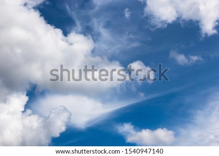 cumulus and high-cumulus clouds of an average tier on blue heavenly space #1540947140