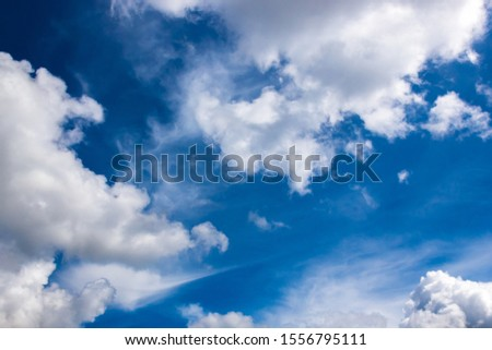 cumulus and high-cumulus clouds of an average tier on blue heavenly space #1556795111