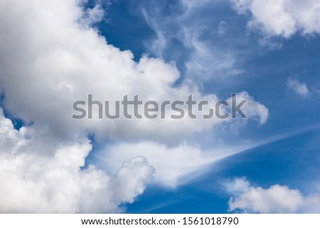cumulus and high-cumulus clouds of an average tier on blue heavenly space #1561018790