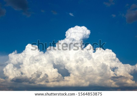 cumulus and high-cumulus clouds of an average tier on blue heavenly space. #1564853875