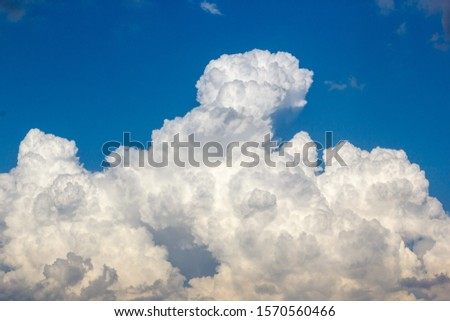 cumulus and high-cumulus clouds of an average tier on blue heavenly space #1570560466