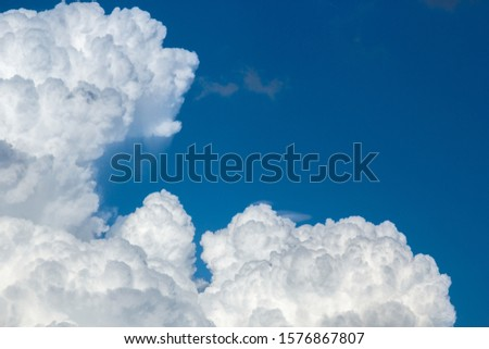 cumulus and high-cumulus clouds of an average tier on blue heavenly space #1576867807