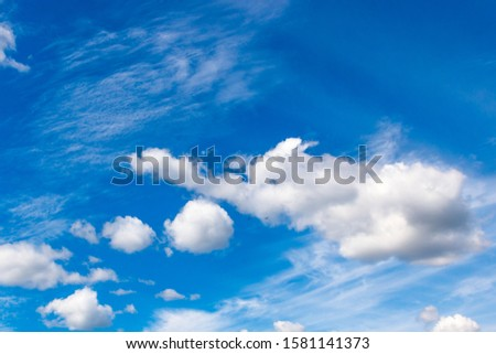 cumulus and high-cumulus clouds of an average tier on blue heavenly space #1581141373