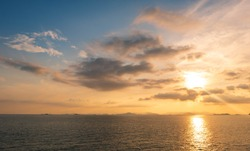 Cumulus cloud on sky and golden light in afternoon and sea