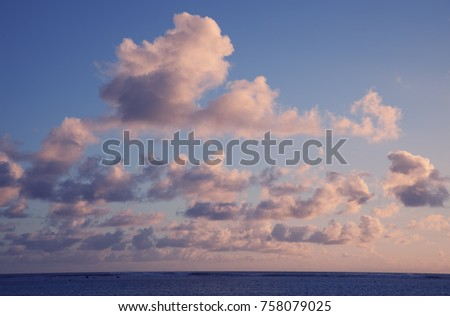 Cumulus Clouds above South Pacific Ocean at Sunset - Rarotonga, Cook Islands, Polynesia