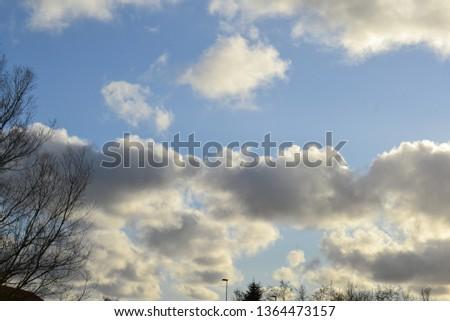 Cumulus Clouds Backlit  #1364473157