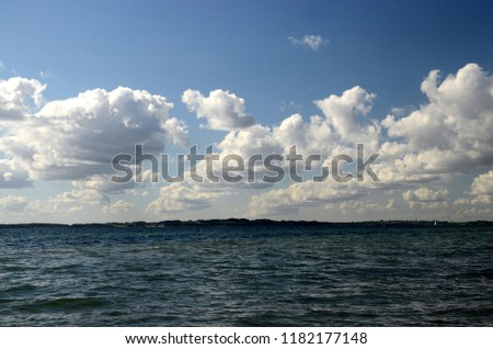 Cumulus clouds over the water performs